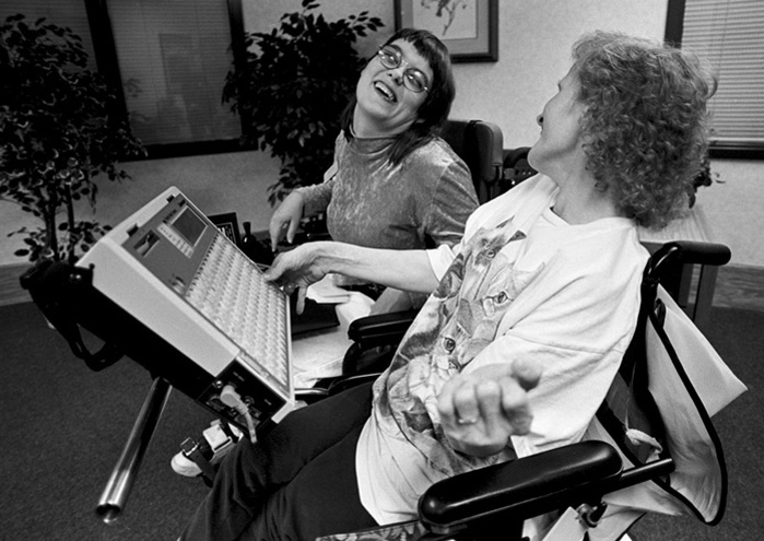 Twice a week Theresa helps friend Judy Backa with the Liberator. This special typing machine will speak what Judy has typed, thus enabling her to communicate. Judy was also born with cerebral palsy.
